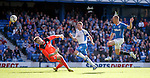 Kenny Miller scores the 4th goal for Rangers as he chips over QoS keeper Alexander Clark