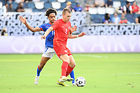 KANSAS CITY, KS - JULY 15: Alistair Johnson #2 of Canada , Martin Experience #17 of Haiti during a game between Canada and Haiti at Children's Mercy Park on July 15, 2021 in Kansas City, Kansas.
