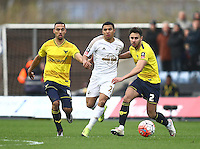 Jefferson Montero of Swansea battles with Kemar Roofe of Oxford United and George Baldock of Oxford United   during the Emirates FA Cup 3rd Round between Oxford United v Swansea     played at Kassam Stadium  on 10th January 2016 in Oxford