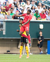 PHILADELPHIA, PA - JUNE 30: Armando Cooper #11 heads the ball in front of Elvis Powell #5 during a game between Panama and Jamaica at Lincoln Financial Field on June 30, 2019 in Philadelphia, Pennsylvania.