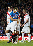 Lee McCulloch uses a novel way of cleaning the ball before his penalty kick