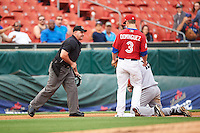 Buffalo Bisons third baseman Matt Dominguez (3) looks to umpire Jeremy Riggs for the call after tagging out Scott Schebler (12) during a game against the Louisville Bats on June 20, 2016 at Coca-Cola Field in Buffalo, New York.  Louisville defeated Buffalo 4-1.  (Mike Janes/Four Seam Images)