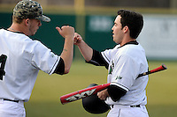 Second baseman Erik Samples (1) of the University of South Carolina Upstate Spartans, right, is congratulated after scoring a run in a game against the Winthrop University Eagles on Wednesday, March 4, 2015, at Cleveland S. Harley Park in Spartanburg, South Carolina. Upstate won, 12-3. (Tom Priddy/Four Seam Images)