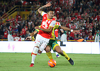 BOGOTA -COLOMBIA, 18-02-2017.Yeison Gordillo (L)  player of Independiente Santa Fe fights the ball against of Emiliano Mendez (R) player of Atletico Huila  during match for the date 4 of the Aguila League I 2017 played at Nemesio Camacho El Campin stadium . Photo:VizzorImage / Felipe Caicedo  / Staff