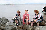 Sean Campbell with Amy and Adam Caffrey at the Green Buoy 1KM Swim in Clogherhead....(Photo credit should read Jenny Matthews/NEWSFILE)...