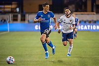 SAN JOSE, CA - MAY 01: Cristian Espinoza #10 of the San Jose Earthquakes looks up to pass the ball during a game between San Jose Earthquakes and D.C. United at PayPal Park on May 01, 2021 in San Jose, California.