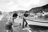 - shipyard for construction of traditional wooden boats in Scilla village, launch ceremony with a sparkling wine bottle ....- cantiere navale per la costruzione di barche in legno tradizionali nel paese di Scilla, cerimonia del varo con una bottiglia di vino spumante