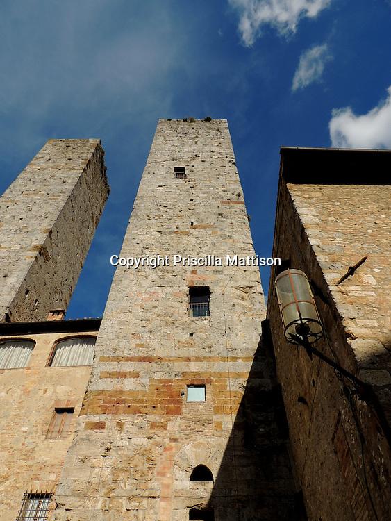 San Gimignano, Italy - Stone towers rise overhead.