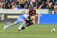Houston, TX -  Friday, December 9, 2016: Foster Langsdorf (2) of the Stanford Cardinal and Colton Storm (6) of the North Carolina Tar Heels battle for a loose ball in the first half of the  NCAA Men's Soccer Semifinals at BBVA Compass Stadium.