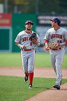 Auburn Doubledays shortstop Jose Sanchez (9) jogs back to the dugout with left fielder Pablo O'Connor (28) during a game against the Batavia Muckdogs on September 1, 2018 at Dwyer Stadium in Batavia, New York.  Auburn defeated Batavia 10-5.  (Mike Janes/Four Seam Images)