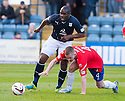 Dundee's Christian Nade gets past Cowdenbeath's Thomas O'Brien.