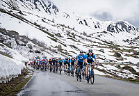 Team Movistar setting the pace up the snowy Cormet de Roselend (2cat/1968m/5.7km@6.5%)<br /> <br /> 73rd Critérium du Dauphiné 2021 (2.UWT)<br /> Stage 7 from Saint-Martin-le-Vinoux to La Plagne (171km)<br /> <br /> ©kramon