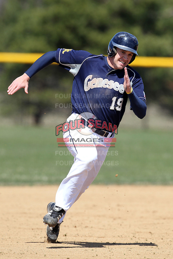 Genesee Community College Cougars outfielder Bryan Pyper #19 during a game against the Ithaca JV team at Genesee Community College on April 9, 2011 in Batavia, New York.  Photo By Mike Janes/Four Seam Images
