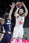 Real Madrid's Sergio Rodriguez (r) and Alba Berlin's Alex King during Euroleague match.March 12,2015. (ALTERPHOTOS/Acero)