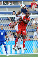 Kevin McKenna (white) defender Canada and Luis Renteria Panama forwrad go up for a header...Canada and Panama tied 1-1 in Gold Cup play at LIVESTRONG Sporting Park, Kansas City, Kansas.