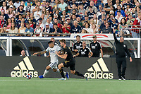 FOXBOROUGH, MA - AUGUST 4: Gustavo Bao #7 of New England Revolution dribbles as Walker Zimmerman #25 of Los Angeles FC pressures during a game between Los Angeles FC and New England Revolution at Gillette Stadium on August 3, 2019 in Foxborough, Massachusetts.