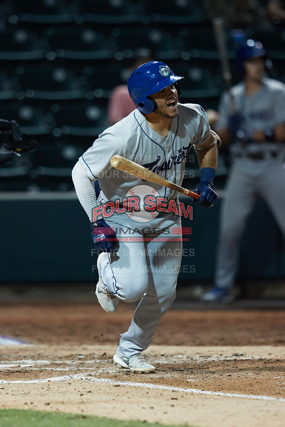 Yainer Diaz (16) of the Asheville Tourists follows through on his swing against the Winston-Salem Dash at Truist Stadium on September 17, 2021 in Winston-Salem, North Carolina. (Brian Westerholt/Four Seam Images)