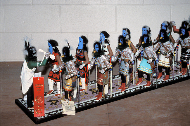 A wooden model of Navajo masked dancer kachinas made from carved cottonwood, painted and decorated with traditional clothing