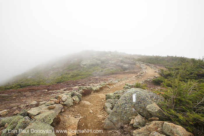 Foggy conditions along the Appalachian Trail (Franconia Ridge Trail) on the summit of Little Haystack Mountain in the White Mountains, New Hampshire USA during the autumn months.