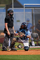 Umpire Tyler Witte and Tampa Bay Rays catcher Dawson Dimon (83) during a Minor League Spring Training game against the Baltimore Orioles on April 23, 2021 at Charlotte Sports Park in Port Charlotte, Florida.  (Mike Janes/Four Seam Images)