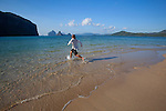 A man runs through the water at a sandbar island near El Nido, in the famous and beautiful Bacuit Archipelago in Palawan, Philippines.