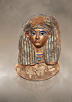 Ancient Egyptian cartonnage funerary mask of Merit - tomb of Kha, Theban Tomb 8 , mid-18th dynasty (1550 to 1292 BC), Turin Egyptian Museum.  Grey background.<br /> <br /> this exquisite guilded catonnage was placed over the head of the mummy of Merit.