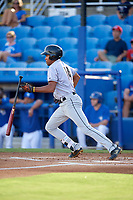 Jupiter Hammerheads center fielder Tristan Pompey (14) follows through on a swing during a game against the Dunedin Blue Jays on August 14, 2018 at Dunedin Stadium in Dunedin, Florida.  Jupiter defeated Dunedin 5-4 in 10 innings.  (Mike Janes/Four Seam Images)