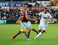 Pictured: Wayne Routledge of Swansea (R) finds it hard to get past two West Ham players Saturday 10 January 2015<br /> Re: Barclays Premier League, Swansea City FC v West Ham United at the Liberty Stadium, south Wales, UK