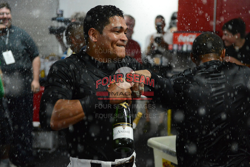 Rochester Red Wings infielder Ray Olmedo celebrates in the locker room after defeating the Scranton Wilkes Barre RailRiders on September 2, 2013 at Frontier Field in Rochester, New York to clinch the International League Wild Card Playoff spot.  (Mike Janes/Four Seam Images)