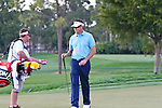 PALM BEACH GARDENS, FL. - Robert Allenby chats with his caddy after a birdie on hole 9 to go into the lead at 4 under par during Round One play at the 2009 Honda Classic - PGA National Resort and Spa in Palm Beach Gardens, FL. on March 5, 2009.
