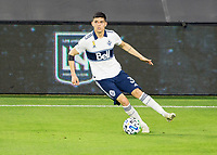 LOS ANGELES, CA - SEPTEMBER 23: Cristian Gutierrez #3 of the Vancouver Whitecaps moves with the ball during a game between Vancouver Whitecaps and Los Angeles FC at Banc of California Stadium on September 23, 2020 in Los Angeles, California.