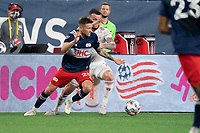 FOXBOROUGH, MA - MAY 22: Amor Traustason #25 of New England Revolution breaks away from Thomas Edwards #7 of New York Red Bulls during a game between New York Red Bulls and New England Revolution at Gillette Stadium on May 22, 2021 in Foxborough, Massachusetts.