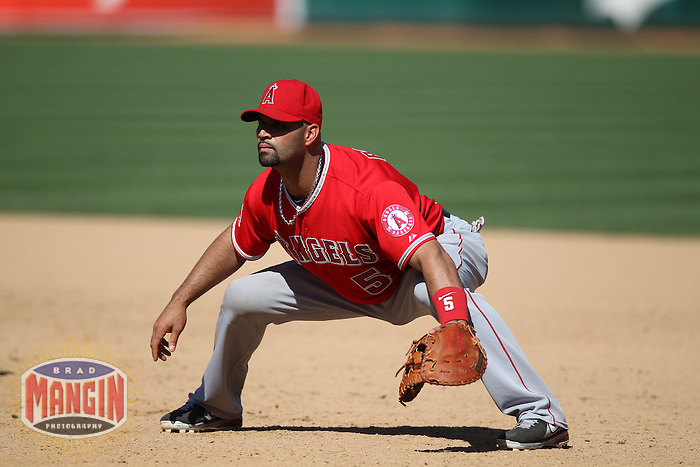 OAKLAND, CA - MAY 1:  Albert Pujols #5 of the Los Angeles Angels plays defense at first base during the game against the Oakland Athletics at O.co Coliseum on May 1, 2013 in Oakland, California. Photo by Brad Mangin