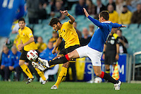 SYDNEY, AUSTRALIA - JULY 31, 2010: Savvas Gentzoglu of Athens kicks the ball during the match between AEK Athens FC and Glasgow Rangers at the 2010 Sydney Festival of Football held at the Sydney Football Stadium on July 31, 2010 in Sydney, Australia. (Photo by Sydney Low / www.syd-low.com)