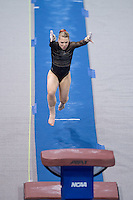 LOS ANGELES, CA - April 19, 2013:  Stanford's Nicole Dayton competes on vault during the NCAA Championships at UCLA.