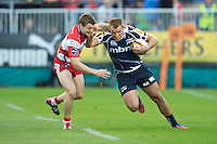 20120803 Copyright onEdition 2012©.Free for editorial use image, please credit: onEdition..Mark Jennings of Sale Sharks hands off Ian Clark of Gloucester Rugby at The Recreation Ground, Bath in the Final round of The J.P. Morgan Asset Management Premiership Rugby 7s Series...The J.P. Morgan Asset Management Premiership Rugby 7s Series kicked off again for the third season on Friday 13th July at The Stoop, Twickenham with Pool B being played at Edgeley Park, Stockport on Friday, 20th July, Pool C at Kingsholm Gloucester on Thursday, 26th July and the Final being played at The Recreation Ground, Bath on Friday 3rd August. The innovative tournament, which involves all 12 Premiership Rugby clubs, offers a fantastic platform for some of the country's finest young athletes to be exposed to the excitement, pressures and skills required to compete at an elite level...The 12 Premiership Rugby clubs are divided into three groups for the tournament, with the winner and runner up of each regional event going through to the Final. There are six games each evening, with each match consisting of two 7 minute halves with a 2 minute break at half time...For additional images please go to: http://www.w-w-i.com/jp_morgan_premiership_sevens/..For press contacts contact: Beth Begg at brandRapport on D: +44 (0)20 7932 5813 M: +44 (0)7900 88231 E: BBegg@brand-rapport.com..If you require a higher resolution image or you have any other onEdition photographic enquiries, please contact onEdition on 0845 900 2 900 or email info@onEdition.com.This image is copyright the onEdition 2012©..This image has been supplied by onEdition and must be credited onEdition. The author is asserting his full Moral rights in relation to the publication of this image. Rights for onward transmission of any image or file is not granted or implied. Changing or deleting Copyright information is illegal as specified in the Copyright, Design and Patents Act 1988. If you are in any way unsure of your right to publish th