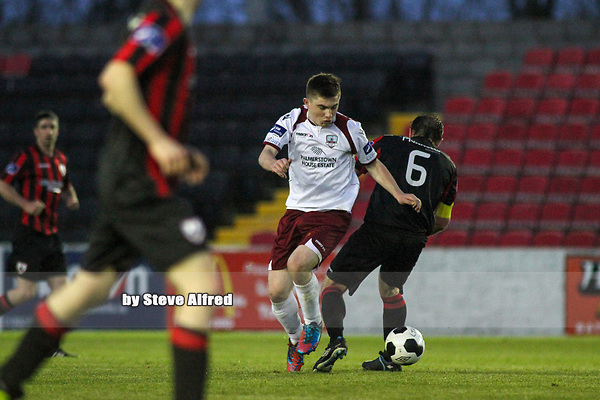 Ryan Manning (At age 17) of Galway FC beats his opponent.<br /> <br /> Longford Town v Galway FC / SSE Airtricity League Division 1 / 26.4.14 / City Calling Stadium, Longford.<br /> <br /> Copyright Steve Alfred / pitchsidephoto.com.