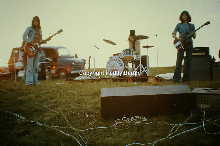 Madhatter Rock Band performing at the Cissbury Ring Festival on the South Downs in the early 1970s.<br /> <br /> Stock Photo by Paddy Bergin