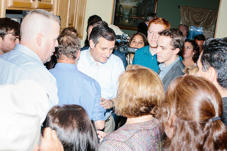 """Texas senator and Republican presidential candidate Ted Cruz greets people after speaking to attendees at an event called """"Smoke a cigar with Ted Cruz"""" at a house party at the home of Linda & Steven Goddu Salem, New Hampshire."""