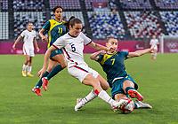 KASHIMA, JAPAN - JULY 27: Kelley O'Hara #5 of the USWNT is tackled by Steph Catley #7 of Australia during a game between Australia and USWNT at Ibaraki Kashima Stadium on July 27, 2021 in Kashima, Japan.