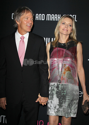 SANTA MONICA, CA - OCTOBER 27:  David E. Kelley and Michelle Pfeiffer at the 8th annual Pink Party hosted by Michelle Pfeiffer to benefit Cedars-Sinai Women's Cancer Program at HANGAR:8 on October 27, 2012 in Santa Monica, California. Credit: mpi21/MediaPunch Inc.