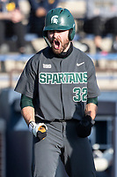Michigan State third baseman Zach Iverson (33) celebrates after scoring against the Michigan Wolverines on March 21, 2021 in NCAA baseball action at Ray Fisher Stadium in Ann Arbor, Michigan. Michigan scored 8 runs in the bottom of the ninth inning to defeat the Spartans 8-7. (Andrew Woolley/Four Seam Images)