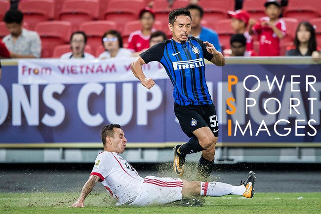 Bayern Munich Defender Rafinha de Souza (L) trips up with FC Internazionale Defender Yuto Nagatomo (R) during the International Champions Cup match between FC Bayern and FC Internazionale at National Stadium on July 27, 2017 in Singapore. Photo by Marcio Rodrigo Machado / Power Sport Images