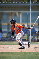 Baltimore Orioles Gerrion Grim (98) follows through on a swing during a minor league Spring Training game against the Tampa Bay Rays on March 29, 2017 at the Buck O'Neil Baseball Complex in Sarasota, Florida.  (Mike Janes/Four Seam Images)