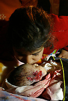 """The brothers of one-month-old Palestinian baby girl Amira Abu Asser cries near her body during her funeral in Gaza city, on March 5, 2008. The baby and a senior Islamic Jihad militant were killed during an Israeli brief military incursion into Gaza today, overshadowing a new peace push by US Secretary of State Condoleezza Rice.""""photo by Fday Adwan"""""""