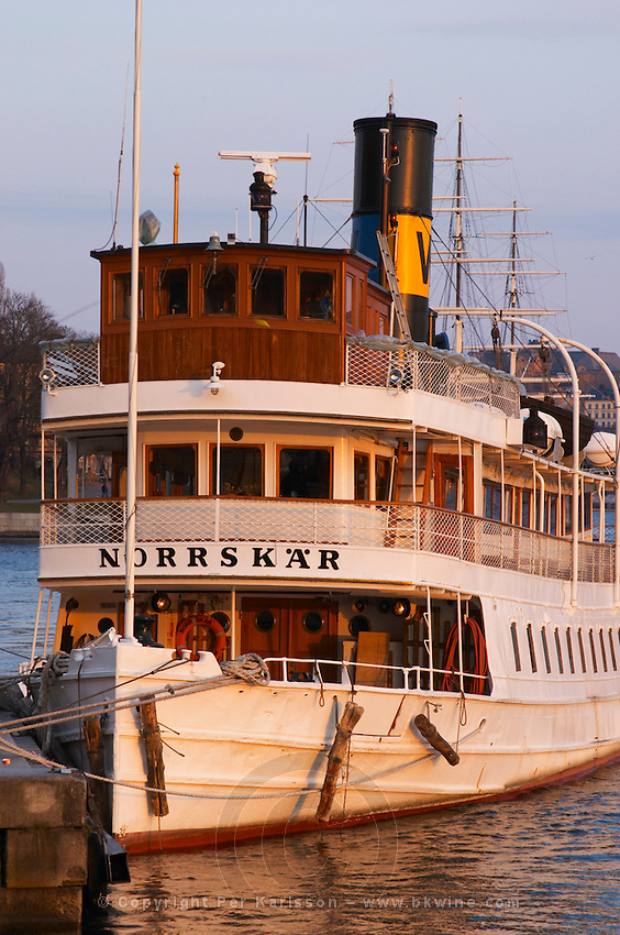 Norrskar moored at the Blasieholmen. White Waxholm boats Waxholmsbatar typical for the archipelago traffic. Stockholm. Sweden, Europe.