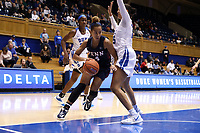 DURHAM, NC - NOVEMBER 29: Kennedy Suttle #4 of the University of Pennsylvania drives past Jade Williams #25 of Duke University during a game between Penn and Duke at Cameron Indoor Stadium on November 29, 2019 in Durham, North Carolina.