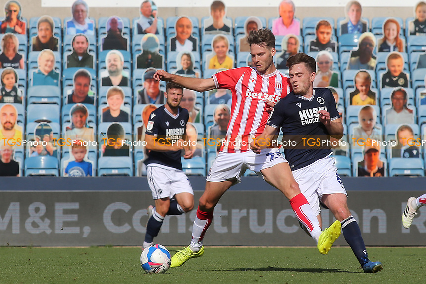 Nick Powell of Stoke City tries to shield the ball from Millwall's Ben Thompson during Millwall vs Stoke City, Sky Bet EFL Championship Football at The Den on 12th September 2020