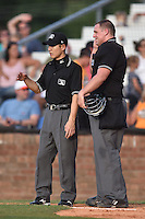 First base umpire Kaz Endo and home plate umpire Ryan Barneycastle between innings of a game between the Kingsport Mets and the Johnson City Cardinals on June 25, 2015 in Johnson City, Tennessee. The Mets defeated the Cardinals 10-8 (Tony Farlow/Four Seam Images)