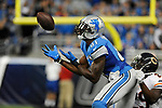 Detroit Lions wide receiver Calvin Johnson (81) catches a 57-yard pass defended by Chicago Bears defensive back Harold Jones-Quartey (29) during the overtime period of an NFL football game, Sunday, Oct. 18, 2015, in Detroit. (AP Photo/Jose Juarez)